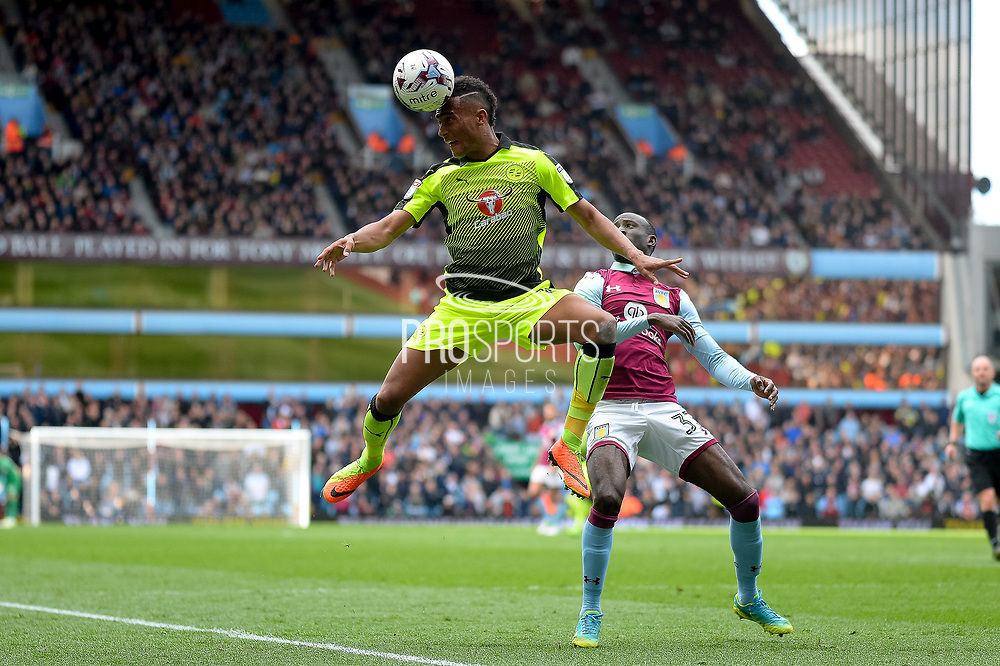 Reading defender Jordan Obita (11) heads the ball during the EFL Sky Bet Championship match between Aston Villa and Reading at Villa Park, Birmingham, England on 15 April 2017. Photo by Dennis Goodwin.