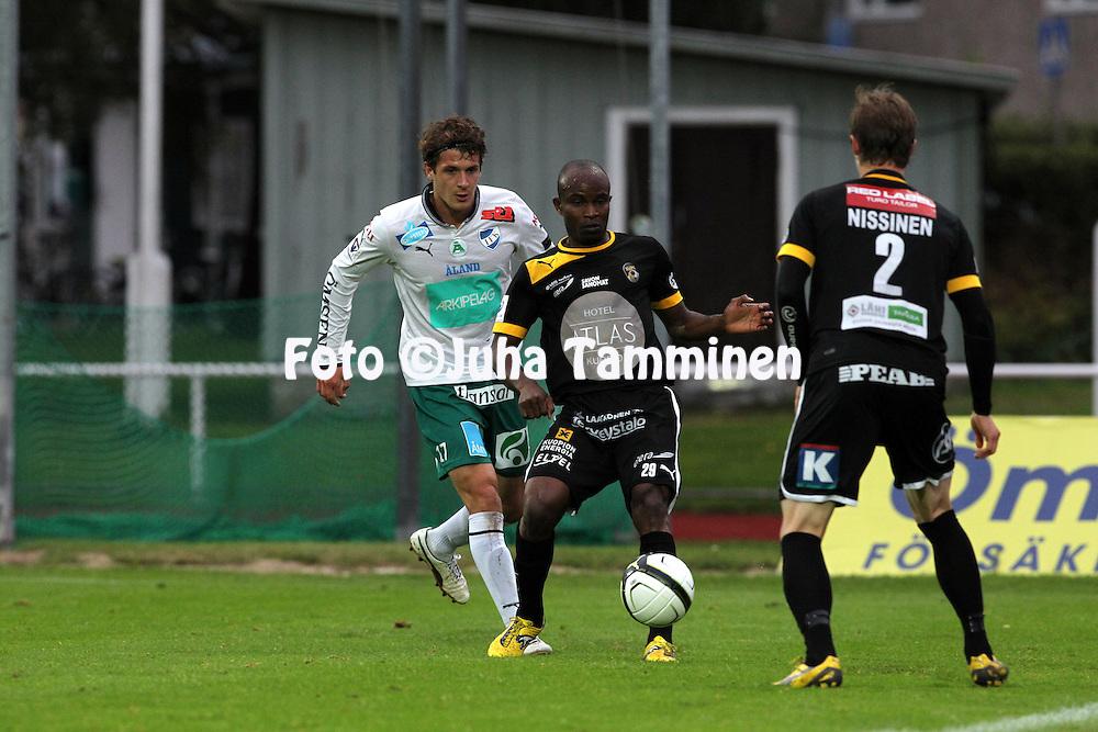 2.9.2012, Wiklof Holding Arena, Mariehamn / Maarianhamina..Veikkausliiga 2012..IFK Mariehamn - Kuopion Palloseura..Macpherlin Omagbemi Dudu (KuPS) v Mason Trafford (IFK).
