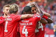 Charlton Athletic forward Lyle Taylor (9) celebrates with teammates after scoring a goal (1-0) during the EFL Sky Bet Championship match between Charlton Athletic and Nottingham Forest at The Valley, London, England on 21 August 2019.
