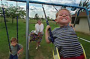 Codey Smith, 3, lets out a big grin as his mother, Carrie, 26, pushes him on the swing. At left, is brother Corey Smith, 5.  Smith's children live with her parents who now have custody of them. As a former heroin addict, she has to drug test twice a week for Child Protective Services. Now she is living in a room and board through Turning Point. April 13, 2000.