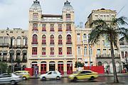 Traffic passes the Hotel 55 Rio in an restored Portuguese colonial building along the Avenida República do Paraguai in the Lapa neighborhood of Rio de Janeiro, Brazil.