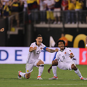 EAST RUTHERFORD, NEW JERSEY - JUNE 17:  Colombian players react to a David Ospina #1 of Colombia save, from left, Carlos Bacca #7, James Rodriguez #10, Juan Cuadrado #11 and Dayro Moreno #17 of Colombia in the penalty shoot out won by Colombia during the Colombia Vs Peru Quarterfinal match of the Copa America Centenario USA 2016 Tournament at MetLife Stadium on June 17, 2016 in East Rutherford, New Jersey. (Photo by Tim Clayton/Corbis via Getty Images)