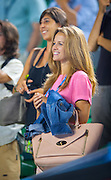 Andy Murray's girlfriend Kim Sears - in pink- looks on as the tennis champion wins his Australian Open day 4 match against Vincent Millot of France.