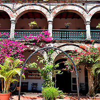Convent de la Popa Courtyard in Cartagena, Colombia<br /> The Convent de la Popa is definitely worth a visit for its historic value, the museum and incredible views of the city below Stern Hill.  Without question, however, the most beautiful feature is this inner courtyard.  Blooming bougainvilleas and other gorgeous flowers grace the two-story, stone arcade in all four directions.