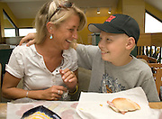 NEWS&GUIDE PHOTO / PRICE CHAMBERS.Ryder and Lea Marshall enjoy a subway lunch in Salt Lake City after a morning of tests and unpleasant hospital scenes.