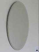 mirror above faucet in bathroom