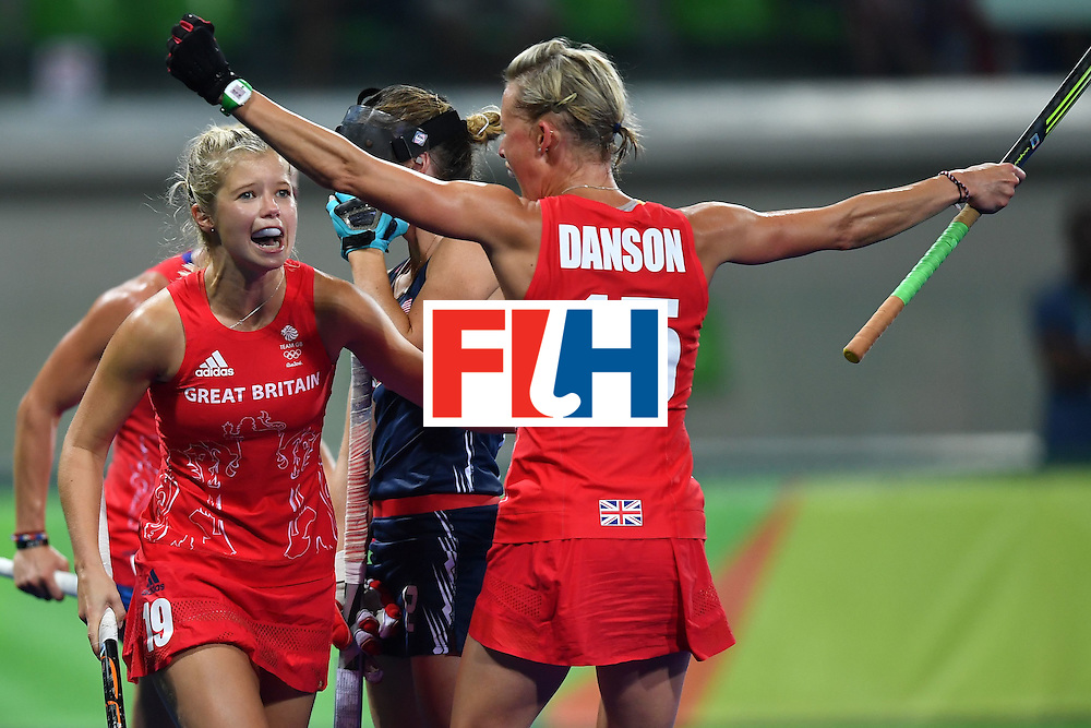 Britain's Alex Danson (R) celebrates scoring a goal with Britain's Susannah Townsend during the women's field hockey Britain vs the USA match of the Rio 2016 Olympics Games at the Olympic Hockey Centre in Rio de Janeiro on August, 13 2016. / AFP / MANAN VATSYAYANA        (Photo credit should read MANAN VATSYAYANA/AFP/Getty Images)