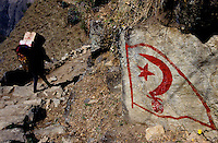 "Kalikot, 05 March 2005... A Maoist logo painted on the rocks. ""Kathmandu has forgotten us, we don't exist for them, they don't care about us. That is why we are fighting against the Regime. If there was no poverty there would be no revolution"" a Maoist says"