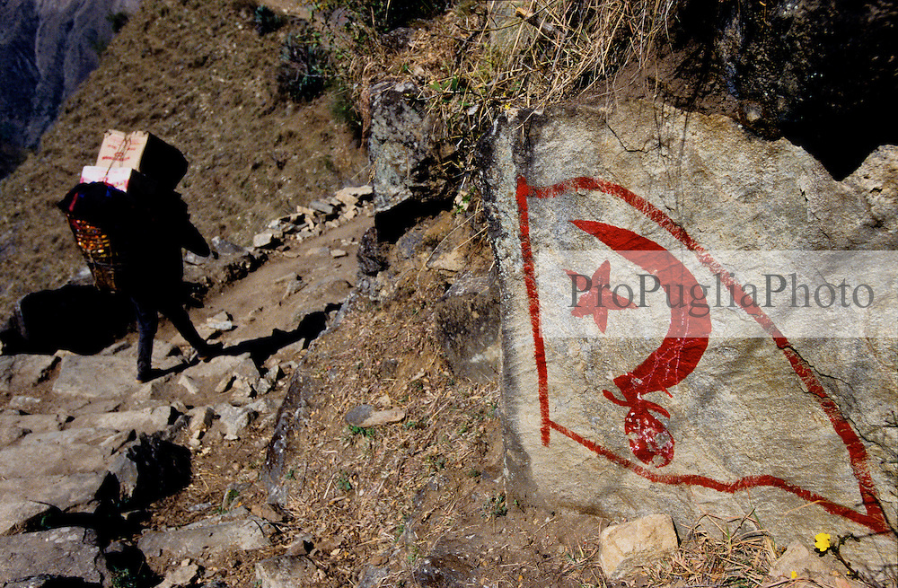 """Kalikot, 05 March 2005... A Maoist logo painted on the rocks. """"Kathmandu has forgotten us, we don't exist for them, they don't care about us. That is why we are fighting against the Regime. If there was no poverty there would be no revolution"""" a Maoist says"""