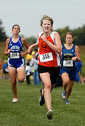 Cape Central's [name redacted] pulls away from Notre Dame's Elizabeth Kiblinger, left, and Saxony Lutheran's Kristin Dippold, right, as they approach the finish line during the girls varsity race at the 9th annual Notre Dame Cross Country Invitational on Saturday, Oct. 2, 2010, at Notre Dame High School in Cape Girardeau.