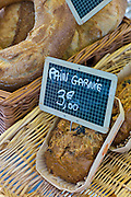 Fresh French bread, pain garnie, on sale for 3 euros at food market at La Reole in Bordeaux region of France