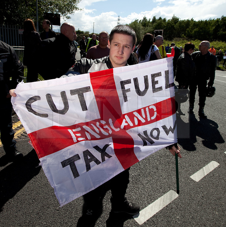 © licensed to London News Pictures. Ellesmere Port, UK 08/05/2011. Fuel protesters blockade the Stanlow Oil Refinery at Ellesmere Port, Cheshire. Organiser, Ian Charlesworth says that a 24 pence discount off the price of a litre of petrol is required to bring the UK in line with average European pricing and to keep British businesses competitive. He says he is expecting more than 1000 vehicles to turn up and is expecting to stay for at least a week. Please see special instructions for usage rates. Photo credit should read Joel Goodman/LNP