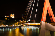 Passerelle du Palais de Justice footbridge and Fourvière Basilica at night, Lyon, France (UNESCO World Heritage Site)