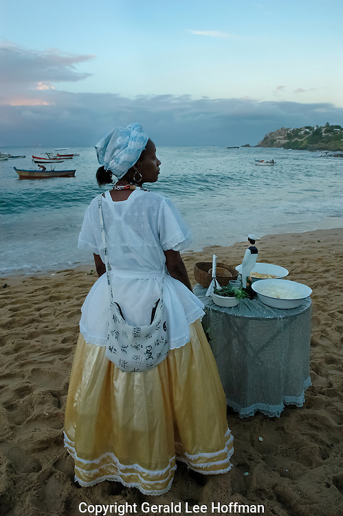 Bahiana waiting to give a blessing on Rio Vermelho beach early morning during the Festa de Yemanja.