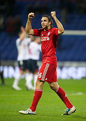 BOLTON, ENGLAND - Sunday, October 31, 2010: Liverpool's Sotirios Kyrgiakos celebrates a late win over Bolton Wanderers during the Premiership match at the Reebok Stadium. (Pic by: David Rawcliffe/Propaganda)