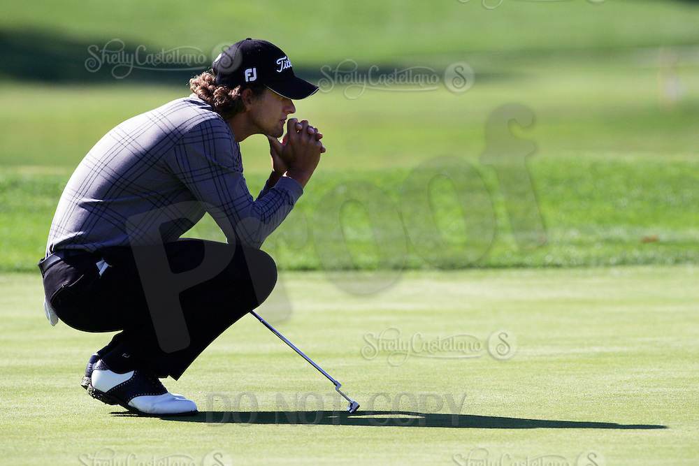 23 February 2006: PGA player Adam Scott contemplates his putt on the second green  on day two of the 2006 World Golf Championships Accenture Match Play Championships in Carlsbad, CA. Adam Scott with long hair.