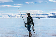 Shore fishing for salmon on Katchemak Bay, Homer, Alaska