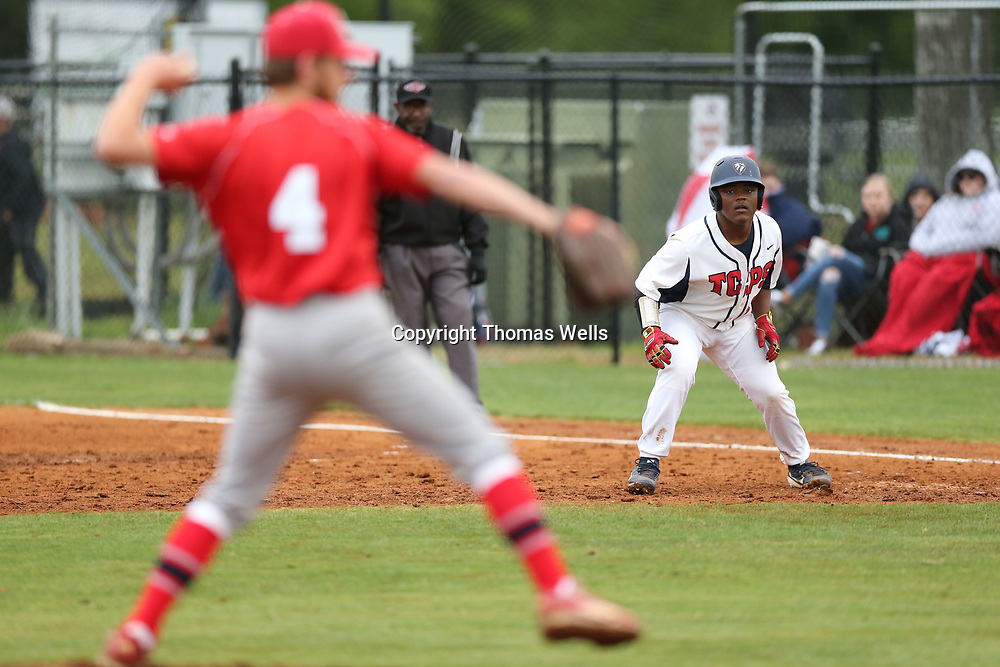 Tashawn Corbitt keeps a close eye on the Pine Grove pitcher Ethan Hudson who entered the game after TCPS scored five runs in the bottom of the first against starting pitcher Brock Lindley.