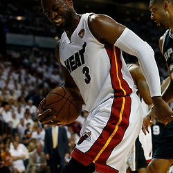Jun 18, 2013; Miami, FL, USA; Miami Heat shooting guard Dwyane Wade (3) grimaces during the first quarter of game six in the 2013 NBA Finals against the San Antonio Spurs at American Airlines Arena.  Mandatory Credit: Derick E. Hingle-USA TODAY Sports