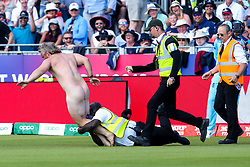 A streaker tries to get away from stewards - Mandatory by-line: Robbie Stephenson/JMP - 03/07/2019 - CRICKET - Emirates Riverside - Chester-le-Street, England - England v New Zealand - ICC Cricket World Cup 2019 - Group Stage