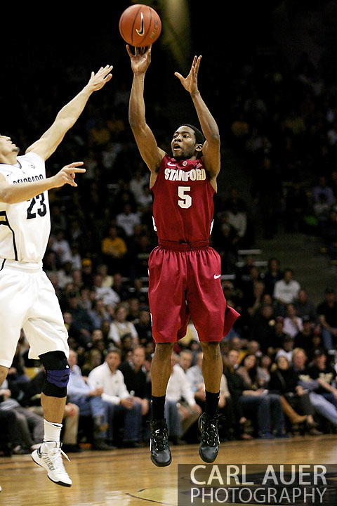 January 24th, 2013 Boulder, CO - sophomore guard Chasson Randle (5) attempts a outside shot over the out stretched arm of Colorado Buffaloes senior guard Sabatino Chen (23) during the NCAA basketball game between the Stanford Cardinal and the University of Colorado Buffaloes at the Coors Events Center in Boulder CO