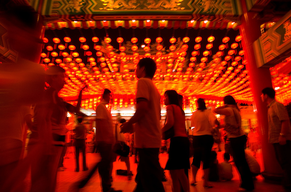 Visitor walk under a lanterns at Thean Hou Temple in Kuala Lumpur, Malaysia. Thean Hou Temple is one of the largest Chinese temples in South-East Asia. The temple completed in 1987 and officially open in 1989 was built by Hainanese community in Kuala Lumpur. Its grand architecture has made it a popular tourist destination.
