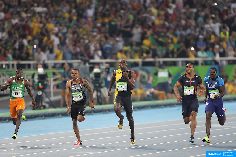 Athletics - Olympics: Day 9  Usain Bolt of Jamaica wins the Men's 100m Final with Justin Gatlin, (right), of the United States in second place and Andre de Grasse of Canada in third place at the Olympic Stadium on August 14, 2016 in Rio de Janeiro, Brazil. (Photo by Tim Clayton/Corbis via Getty Images)