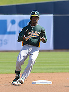 PHOENIX, AZ - FEBRUARY 23:  Jemile Weeks #19 of the Oakland Athletics rounds second base in the spring training game against the Milwaukee Brewers at Maryvale Baseball Park on February 23, 2013 in Phoenix, Arizona.  (Photo by Jennifer Stewart/Getty Images)
