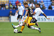 Bolton Wanderers midfielder Liam Trotter (17) tries a sliding tackle on Bradford City striker Billy Clarke (10) during the EFL Sky Bet League 1 match between Bolton Wanderers and Bradford City at the Macron Stadium, Bolton, England on 24 September 2016. Photo by Simon Brady.