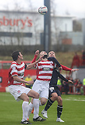 Eye on the ball Hamilton Academical's Martin Canning and  Grant Gillespie and Dundee's Ryan Conroy - Hamilton v Dundee, SPFL Championship at <br /> New Douglas Park<br /> <br />  - &copy; David Young - www.davidyoungphoto.co.uk - email: davidyoungphoto@gmail.com