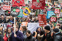 "London, April 16th 2016. Protesters march past St Martin In-the-Fields Church towards Trafalgar Square as thousands of people supported by trade unions and other rights organisations demonstrate against the policies of the Tory government, including austerity and perceived favouring of ""the rich"" over ""the poor""."