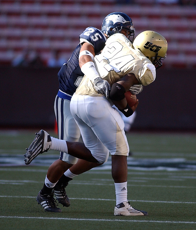 Nevada's Sergio Villasenor tackles Central Florida running back Kevin Smith during the 2005 Sheraton Hawai'i Bowl at Aloha Stadium in Honolulu, Dec. 24, 2005.<br />