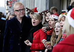 © Licensed to London News Pictures. 20/12/2011. London, United Kingdom .Chris Evans watches the Military Wives Choir as they sing to the public outside of HMV on Oxford Street to celebrate the success of their single..Photo credit : Chris Winter/LNP