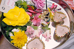 Flowers and divas on a tray of offering in celebration of Navratri; the Hindu festival of Nine Nights,