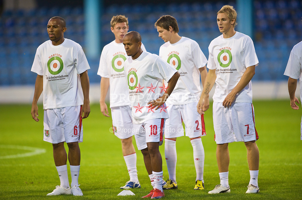 PODGORICA, MONTENEGRO - Wednesday, August 12, 2009: Wales' Daniel Gabbidon, Simon Church, Robert Earnshaw, Chris Gunter and Jack Collison warm-up wearing a shirt in support of former captain John Hartson who is battling against cancer, and to promote awareness of men's health issues with web site checkemlads.com, before an international friendly match against Montenegro at the Gradski Stadion. (Photo by David Rawcliffe/Propaganda)