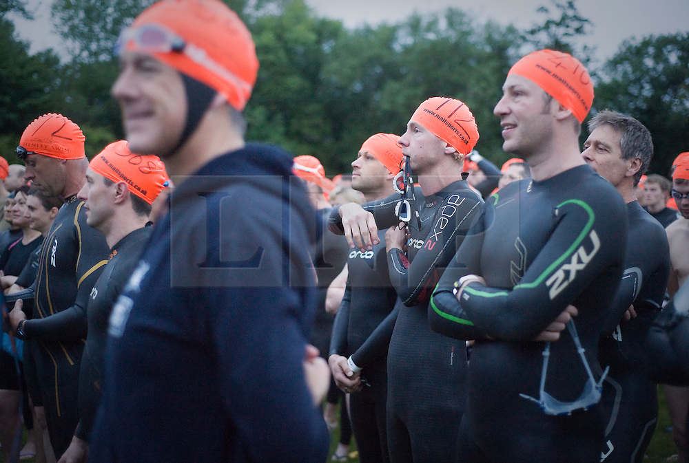 © Licensed to London News Pictures. 26/06/2011. Henley-on-Thames, UK. Competitors listen to instructions at the start. Swimmers take part in the Henley Swim at dawn this morning (26/06/2011). The annual event sees competitors swim the length of the 2.1km course of the Henley Royal Regatta on the River Thames, after arriving in darkness, and walking half a mile to the start at sunrise. See special instructions. Photo credit should read: Ben Cawthra/LNP