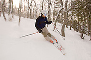 An alpine skier skis the extreme backcountry section of Mount Bohemia ski resort in Michigans Upper Peninsula.