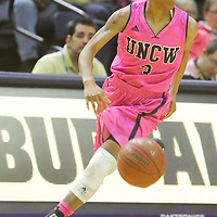 UNCW's Kelva Atkins drives against Northeastern Sunday February 15, 2015 at Trask Coliseum. (Jason A. Frizzelle)