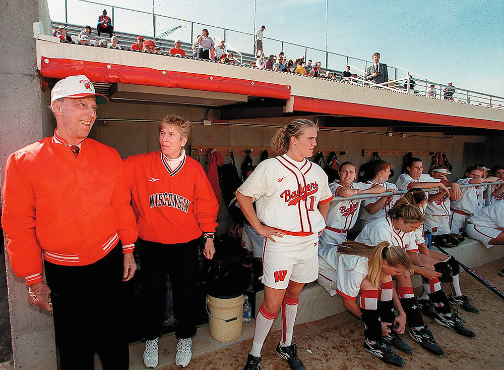 Wisconsin coach Karen Gallagher pats Bob Goodman on the back during opening ceremonies and dedication of the Robert and Irwin Goodman Softball Complex Tuesday.  (Photo © Andy Manis)