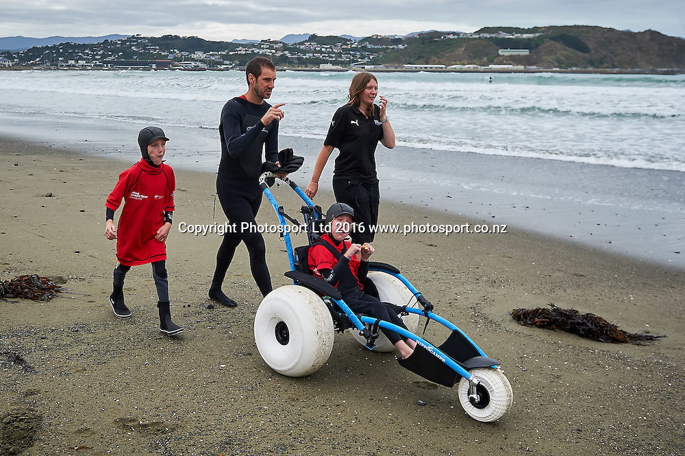 Participants head down the beach to go surfing during the Flight Centre Foundation Halberg Surf Day, Lyall Bay, Wellington, New Zealand. Saturday 12 March 2016. Copyright Photo: Mark Tantrum/www.Photosport.co.nz