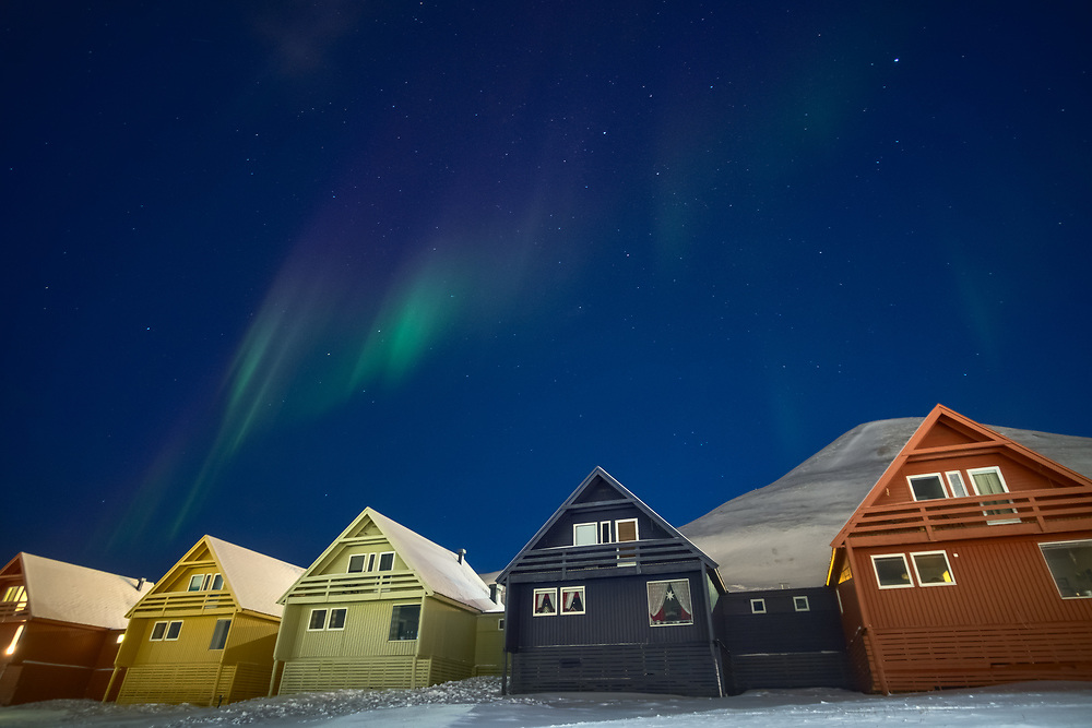 Unlike the majority of places where one can observe the Northern Lights only during nighttime, the skies of Longyearbyen are often illuminated by green, purple and pink even during daytime.