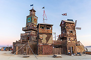 The Folly<br /> by: Dave Keane & The Folly Builders<br /> from: San Francisco, CA<br /> year: 2019<br /> <br /> The Folly represents an imaginary shantytown of funky climbable towers and old western storefronts, cobbled together from salvaged and reclaimed lumber from original San Francisco Victorians to be reborn in the desert, affording shelter, entertainment and perspective to the community.<br /> <br /> URL: www.thefollybrc.com<br /> Contact: info@thefollybrc.com<br /> <br /> https://burningman.org/event/brc/2019-art-installations/?yyyy=&artType=H#a2I0V000001AVkAUAW My Burning Man 2019 Photos:<br />
