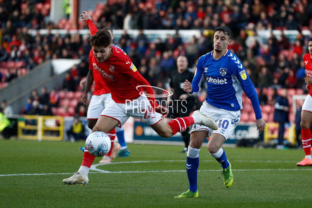 Swindon Town defender Rob Hunt and Mohamed Maouche (10) of Oldham Athletic during the EFL Sky Bet League 2 match between Swindon Town and Oldham Athletic at the County Ground, Swindon, England on 14 December 2019.