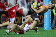 Dylan Shiel of the Giants is tackled by Craig Bird of the Swans during the AFL Round 14 match between the Sydney Swans and the GWS Giants at ANZ Stadium, Sydney. (Photo: Craig Golding/AFL Media)