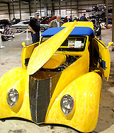 George Fain of South Charleston (left) and Ron Yates of Springfield look at Jim Burnett of Greensfork, Indiana's 1937 Ford during the KOI Hot Rod Fest Dayton at the Dayton Airport Expo Center in Vandalia, Sunday, March 12, 2012.