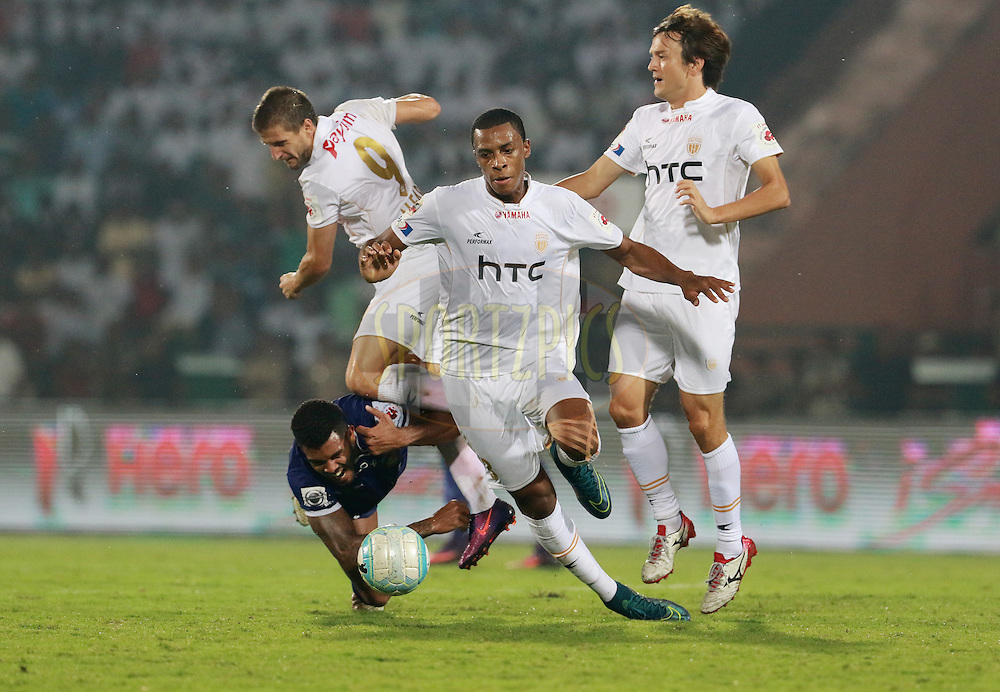 Raphael Augusto of Chennaiyin FC collides with Emiliano Alfaro of NorthEast United FC as he tries to get past the defence of NorthEast United FC during match 18 of the Indian Super League (ISL) season 3 between NorthEast United FC and Chennaiyin FC held at the Indira Gandhi Athletic Stadium in Guwahati, India on the 20th October 2016.<br /> <br /> Photo by Vipin Pawar / ISL/ SPORTZPICS
