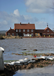 © Licensed to London News Pictures. Date 07/02/2014. Moorland, Somerset. Home surrounded by flood water.  Evacuated village of Moorland in Somerset. All residents have been evacuated as the flood waters continue to rise today.. Photo credit : MarkHemsworth/LNP