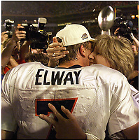 Staff Photo - Preston C. Mack ..SuperBowl XXXIII..Broncos QB John Elway celebrates his Superbowl victory with his wife Janet.