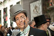 A smiling man in a top hat and pince-nez glasses.