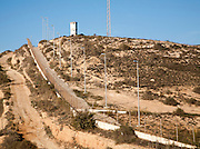 Security fence and look-out tower of military base in Melilla autonomous city state Spanish territory in north Africa, Spain